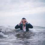 Overwhelmed Man in rough water