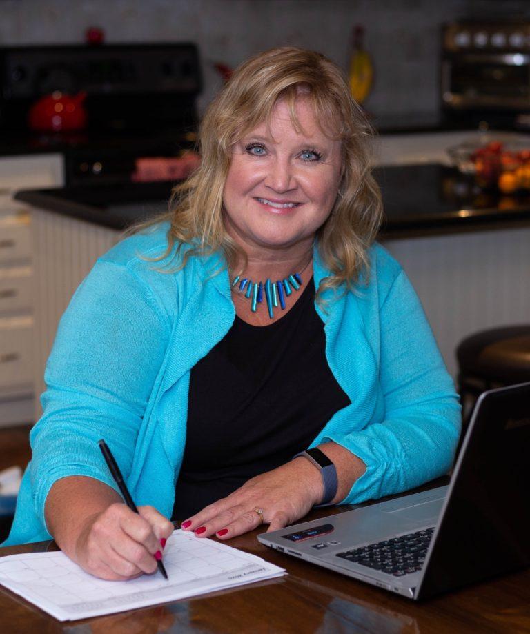 Lynne Edris Working on Calendar at laptop