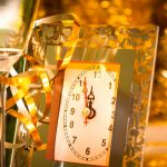 new year clock with champagne and confetti