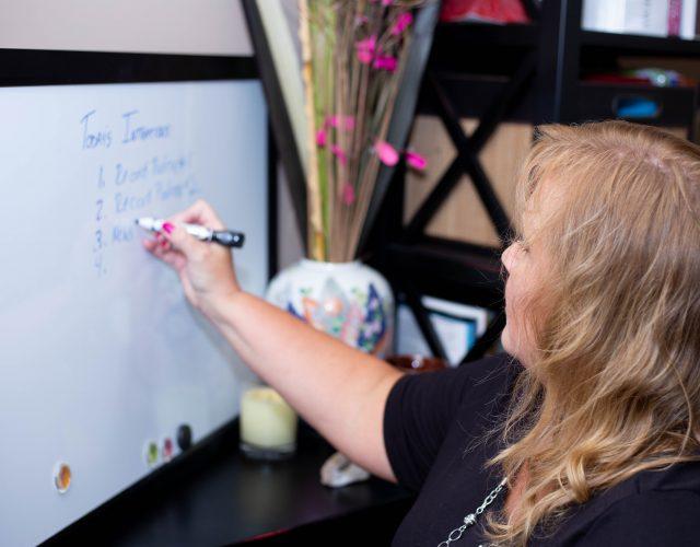 Lynne writing on whiteboard