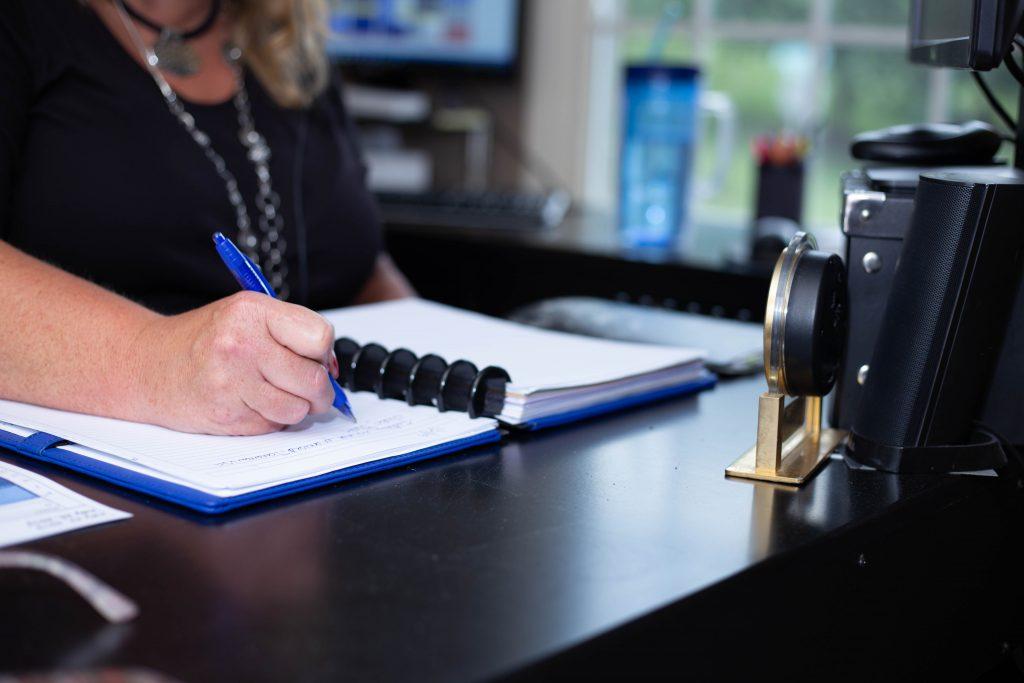 Lynne writing in notebook