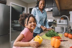 Mother and child chopping vegetables